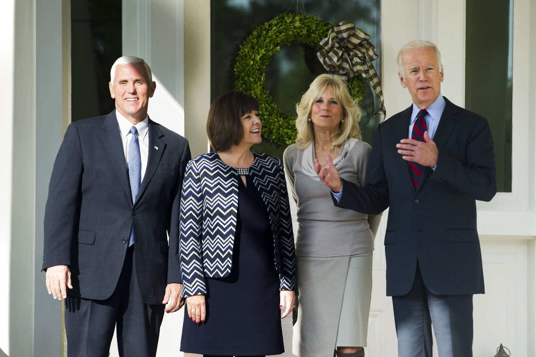 Vice President Joe Biden and Dr. Jill Biden pose for a photograph with Vice President-elect Mike Pence and his wife Karen after they had lunch at the Vice President's residence, the Naval Observatory, in Washington, Wednesday, Nov. 16, 2016. (AP Photo/Cliff Owen)