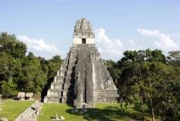 In this photograph taken Dec. 6, 2016, Temple I, also known as Temple of the Great Jaguar, is seen during a sunny day in northern Guatemala's Tikal National Park. The sprawling park in northern Guatemala is one of the country's top travel attractions, showcasing the Mayan civilization's engineering feats. (AP Photo/Manuel Valdes)