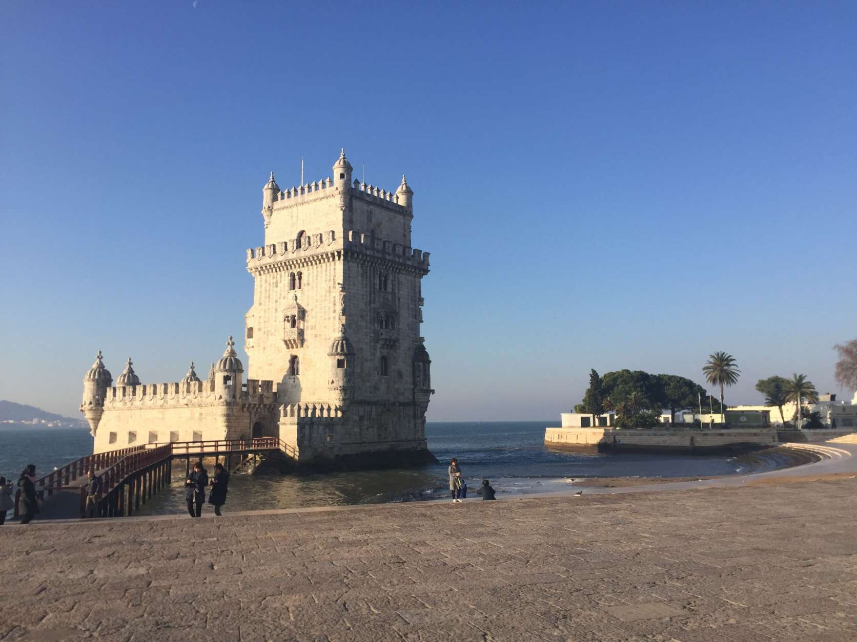 This Jan. 20, 2017 photo shows the Tower of Belem on the banks of the Tagus River in Lisbon, Portugal. The picturesque fortress is a UNESCO World Heritage site and one of Lisbon's most famous landmarks. It dates to the 16th century when Portuguese explorers sailed the globe, establishing a colonial empire that stretched from Asia to Africa to South America. (AP Photo/Beth J. Harpaz)