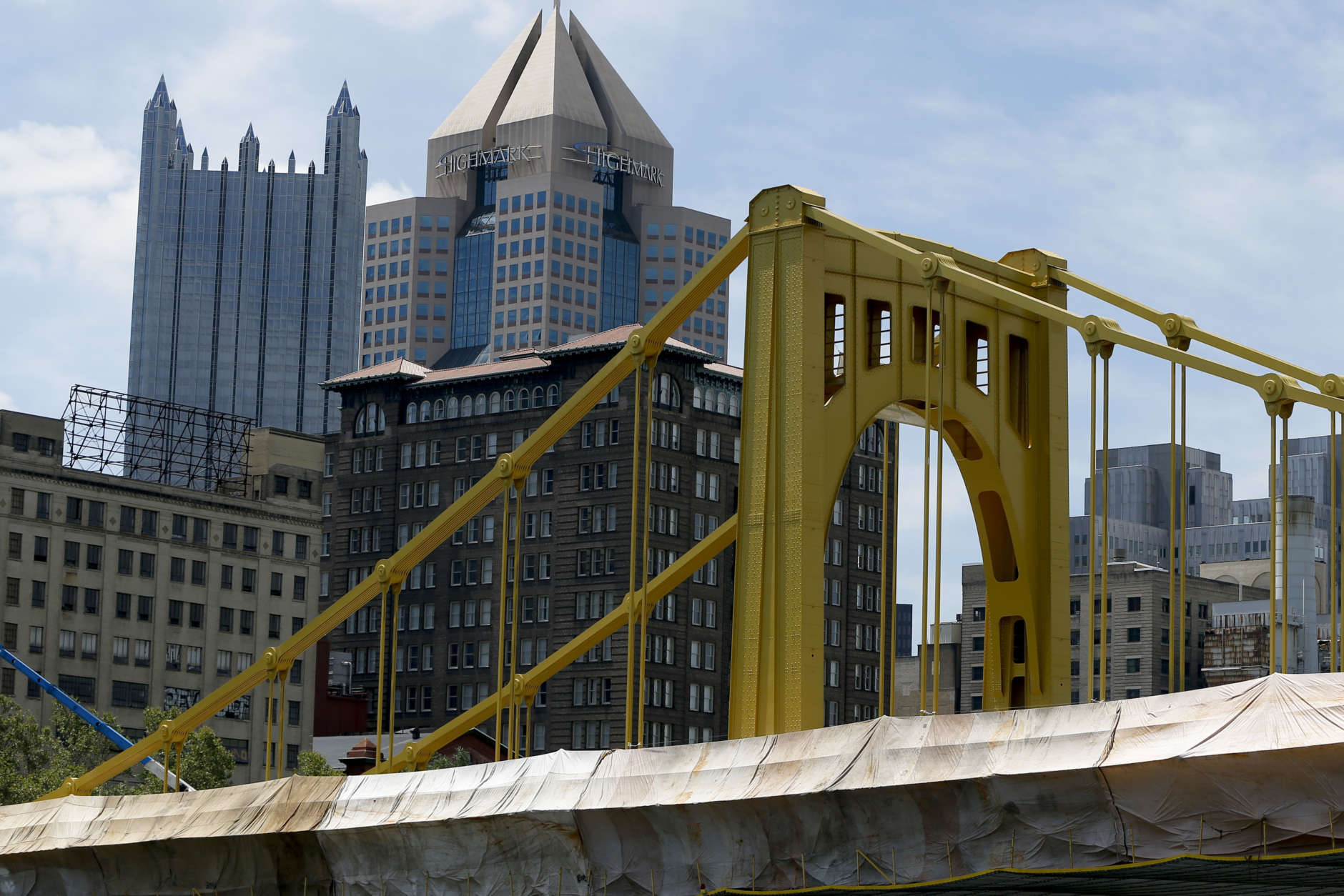 The tops to the PPG Tower spires, left, and the Fifth Avenue Place rise above the Andy Warhol Bridge in the Pittsburgh skyline, Wednesday, July 26, 2017. (AP Photo/Keith Srakocic)