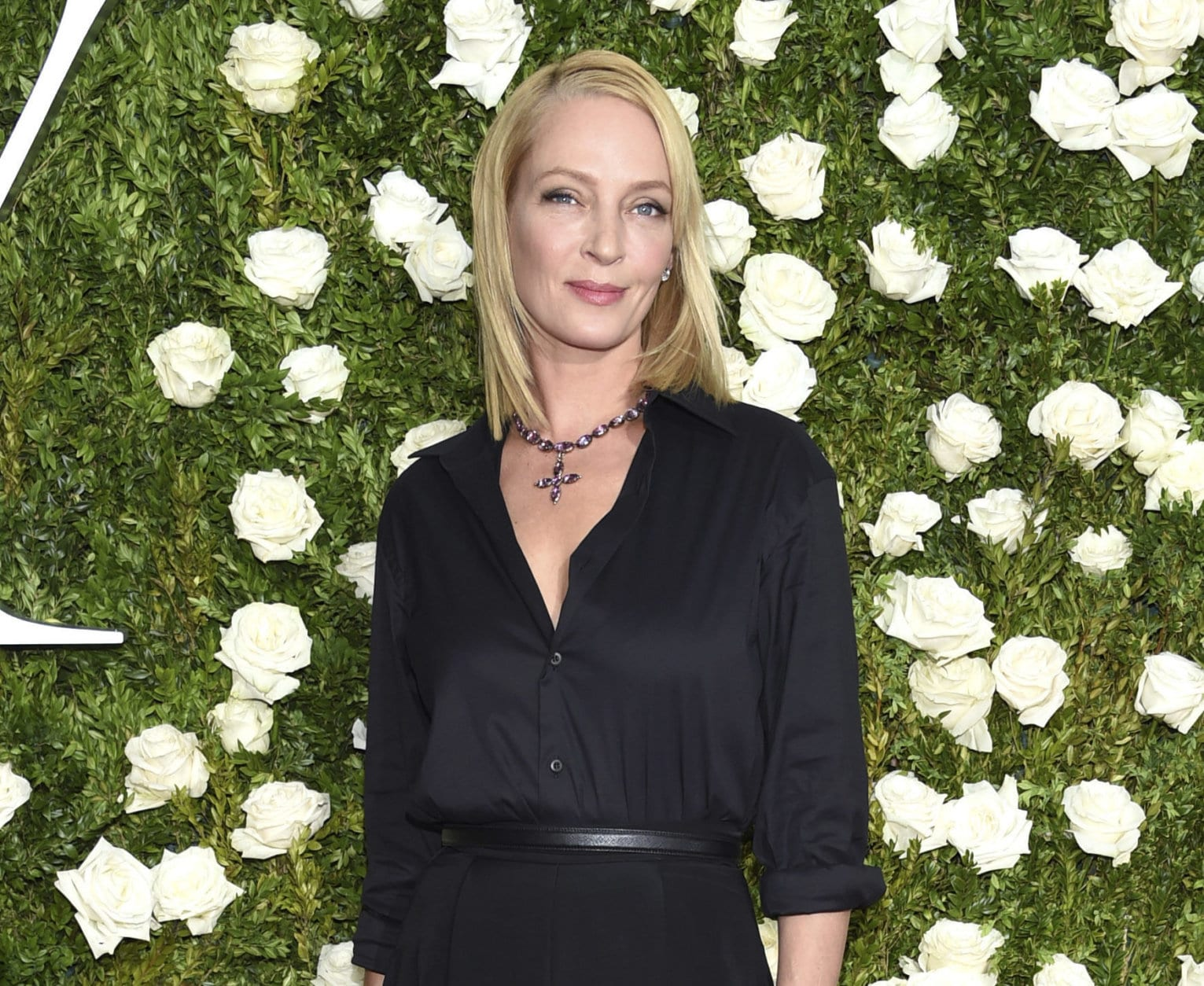 """FILE - In this June 11, 2017 file photo, Uma Thurman arrives at the 71st annual Tony Awards in New York. Thurman wished everyone a happy Thanksgiving except disgraced movie mogul Harvey Weinstein, saying in a cryptic online post that he doesn't """"deserve a bullet.""""  Thurman starred in the Weinstein-produced films """"Pulp Fiction"""" and the """"Kill Bill"""" films. (Photo by Evan Agostini/Invision/AP, File)"""