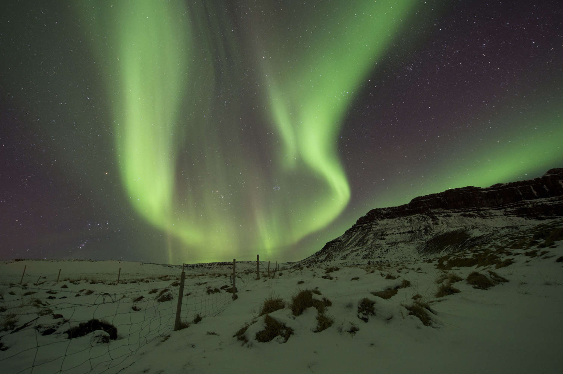 File-In this March 1, 2017, file photo the Northern Lights, or aurora borealis, appear in the sky over Bifrost, Western Iceland. The Northern Lights are created as a result of collisions between gaseous particles in the Earth's atmosphere and charged particles released by the sun, according to the Northern Lights Space and Science Centre in Canada. (AP Photo/Rene Rossignaud, File)