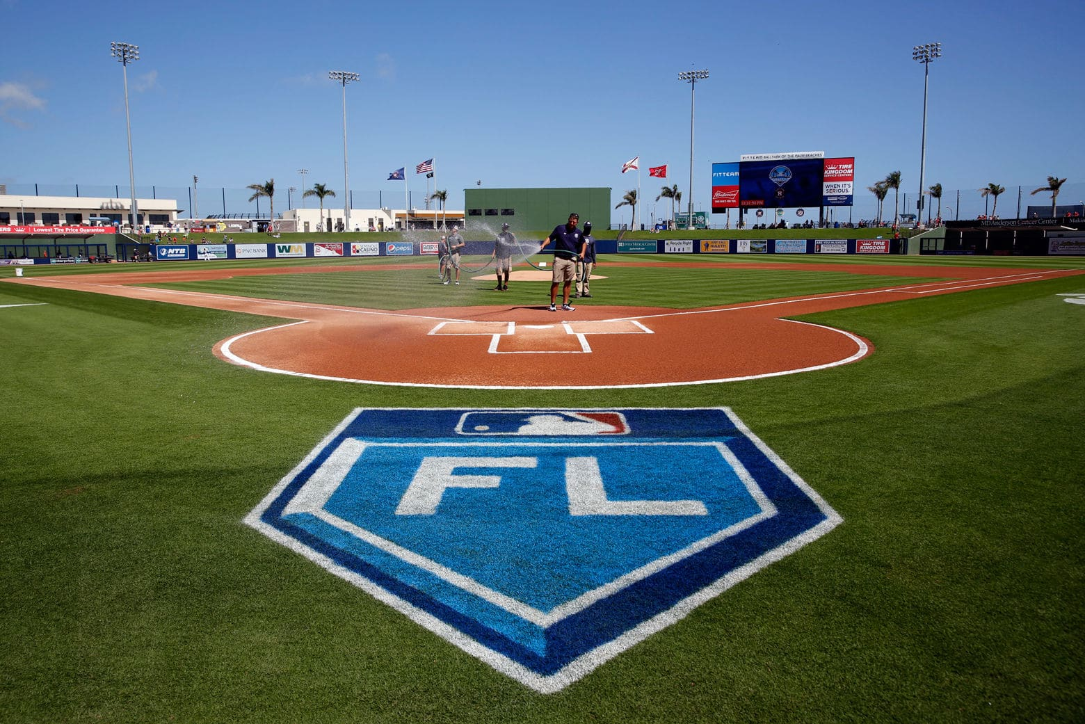 Members of the grounds crew prepare the field before the start of an exhibition spring training baseball game between the Washington Nationals and Houston Astros Friday. (AP Photo/Jeff Roberson)