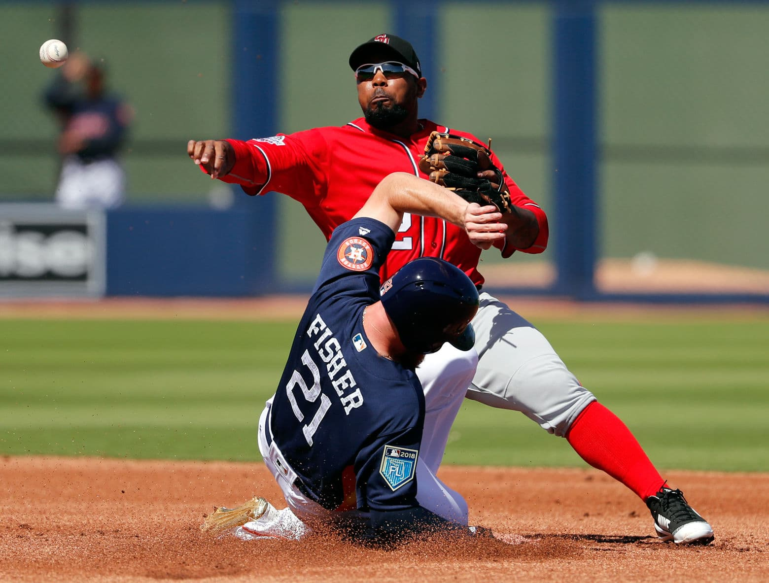 Houston Astros' Derek Fisher (21) is out at second as Washington Nationals second baseman Howie Kendrick turns the double play to end the first inning of an exhibition spring baseball game Friday.  (AP Photo/Jeff Roberson)