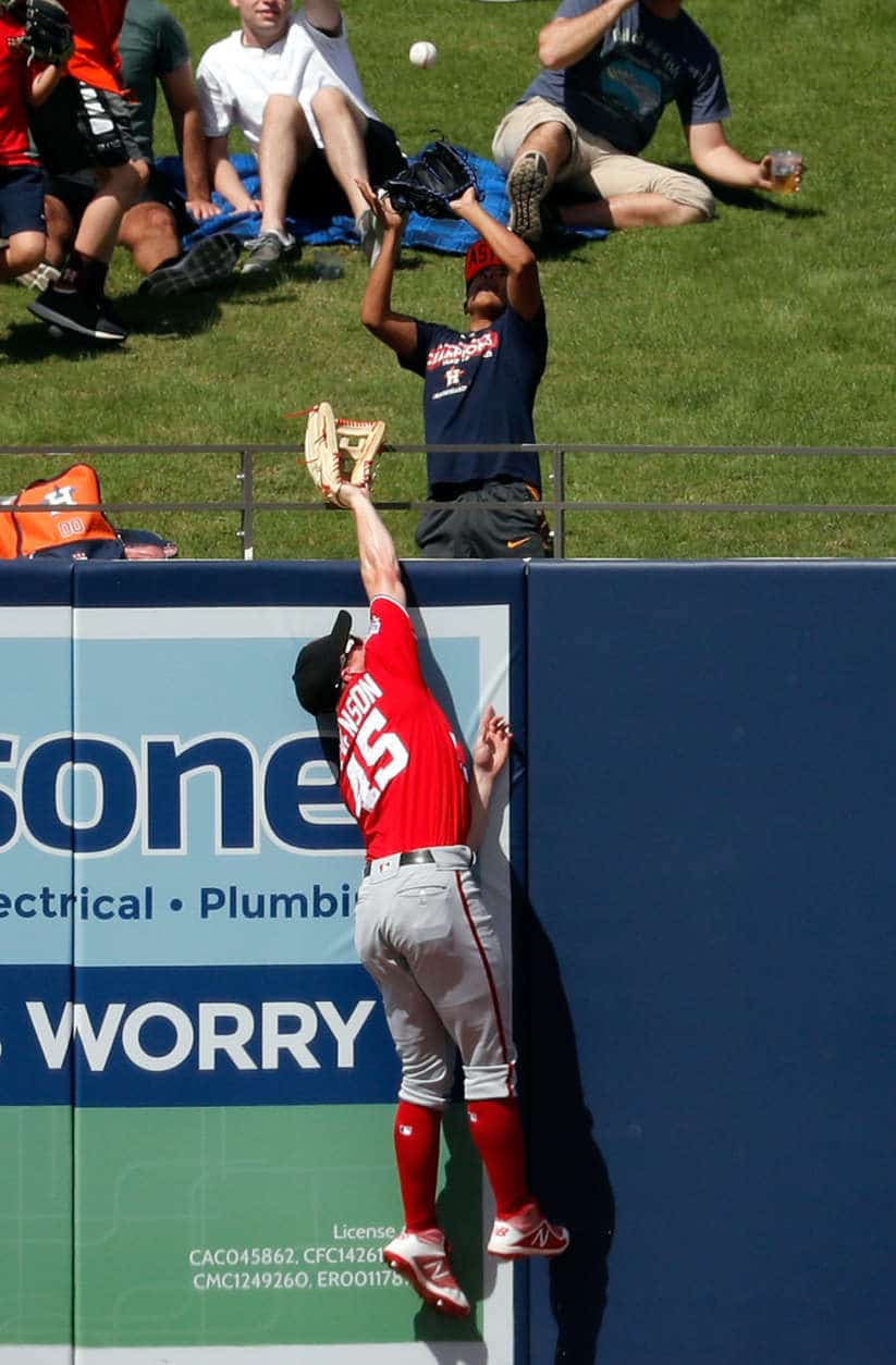Washington Nationals left fielder Andrew Stevenson is unable to catch a two-run home run by Houston Astros' Max Stassi during the third inning of an exhibition spring baseball game Friday. (AP Photo/Jeff Roberson)