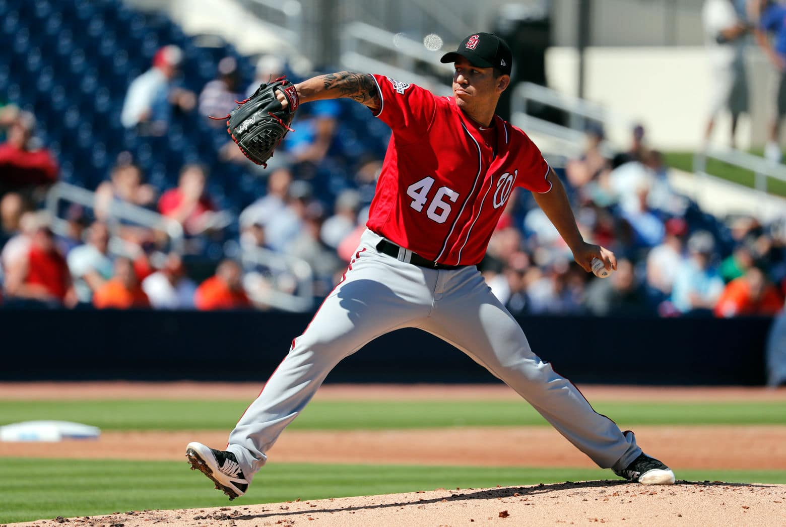 Washington Nationals pitcher Tommy Milone throws during the first inning of an exhibition spring training baseball game against the Houston Astros Friday. (AP Photo/Jeff Roberson)