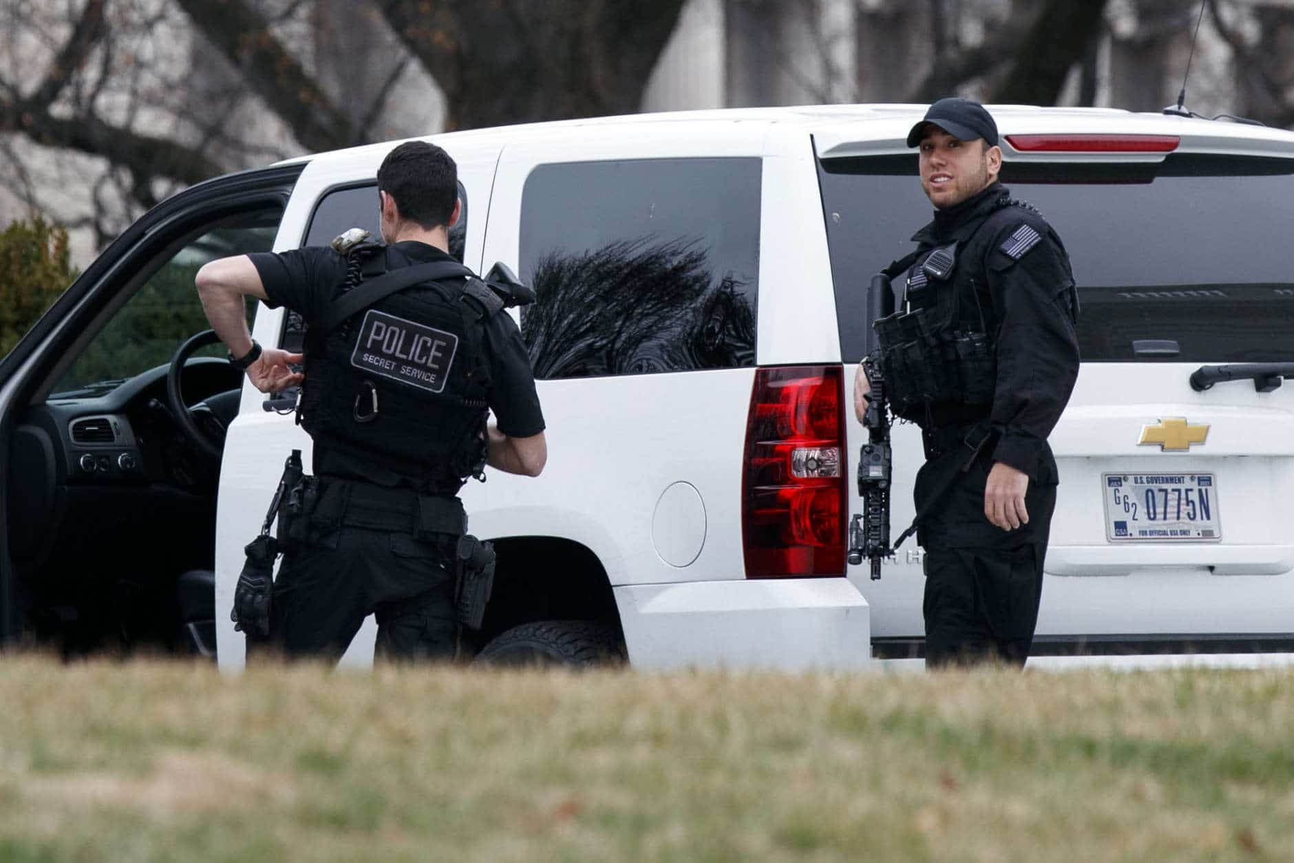 Secret Service officers stand on the North Lawn of the White House after a vehicle rammed a barrier near the White House, Friday, Feb. 23, 2018, in Washington. (AP Photo/Evan Vucci)