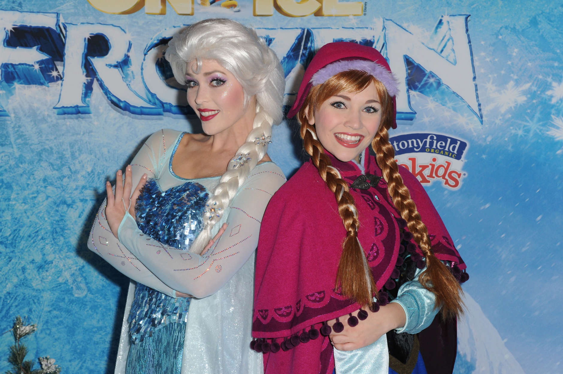 Elsa the Snow Queen, left, and Princess Anna attend Frozen celebrity premiere presented by Disney On Ice held at the Staples Center on Thursday, Dec.10, 2015, in Los Angeles. (Photo by Richard Shotwell/Invision/A P)