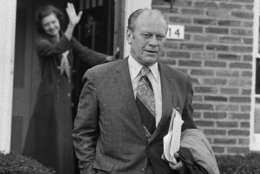 Vice President Gerald Ford gets a wave from his wife Betty early Friday as he left their home in Alexandria on Dec. 7, 1973.  It will be his first full day in his new position following formal swearing in ceremonies on Thursday evening in the House of Representatives chamber. (AP Photo)