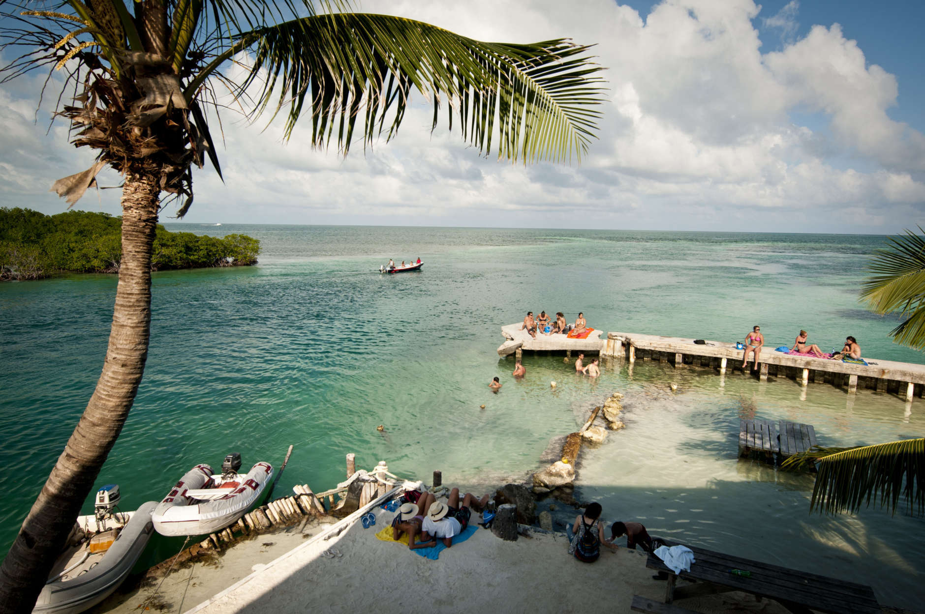 This undated photo provided by The Belize Tourism Board shows vacationers relaxing at Caye Caulker, Belize. The beach town is a laid-back, low-cost base for tourists looking to explore a nearby barrier reef. (AP Photo/The Belize Tourist Board)