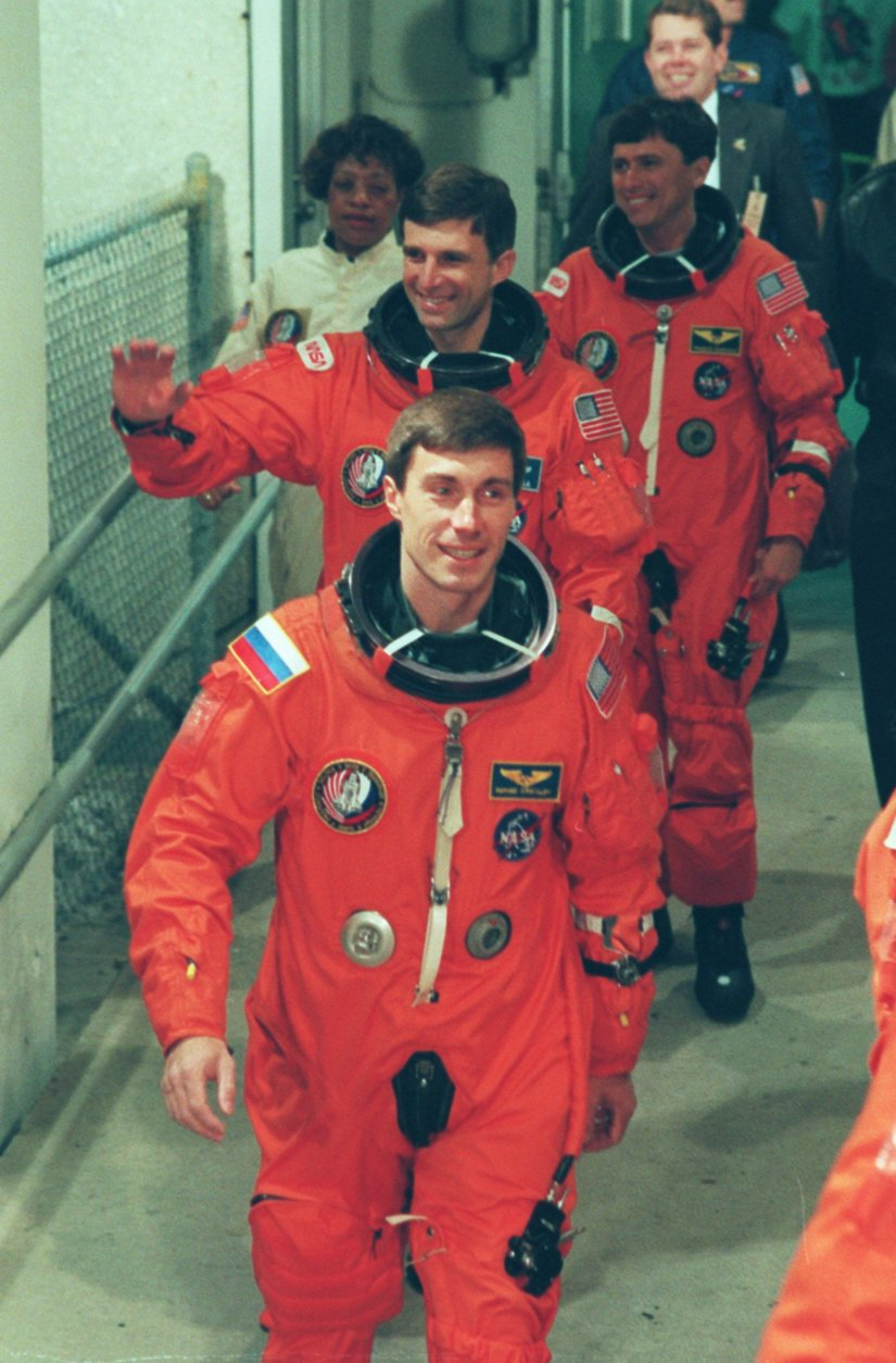 FILE--Russian cosmonaut Sergei Krikalev, front, a Mission Specialist on STS-60 leads fellow Mission Specialists Ronald Sega and Franklin Chang-Diaz out of the Operations and Checkout Building heading for Launch Pad 39-A and a planned 7:10 a.m. EST lift-off aboard the Space Shuttle Discovery Feb. 3, 1994. Krikalev is the first Russian to fly on a U.S. Space Shuttle. (AP Photo/Terry Renna)