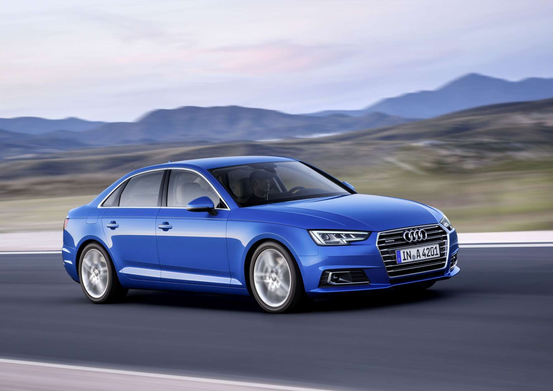 In this image released on Thursday, March 3, 2016, an Audi A4 in crystal effect paint finish Ara Blue is seen on the road. The Audi Group plans to launch more than 20 new or revised models and to continue its growth in 2016. Despite major challenges, the Ingolstadt-based company performed successfully last year and set a new record for unit sales with 1,803,246 automobiles. Press release and media available to download at www.apassignments.com/newsaktuell. (Audi AG via AP Images)