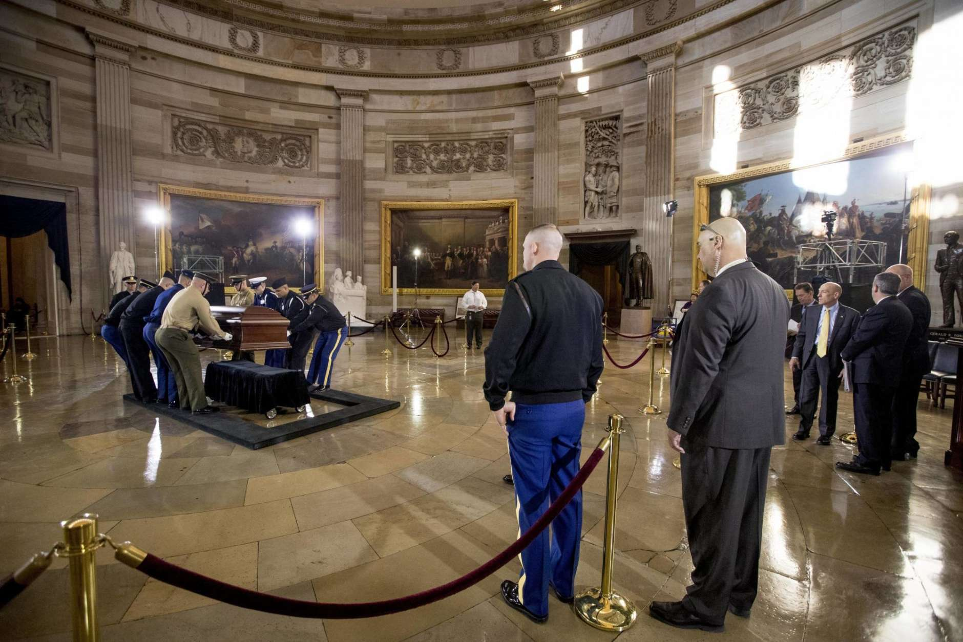 Military members practice placing a casket in the Rotunda of the Capitol, Tuesday, Feb. 27, 2018  in Washington, for the late Rev. Billy Graham to lie in honor tomorrow.  President Tump, Congressional leaders and the Graham family will be in attendance.  (AP Photo/Andrew Harnik)