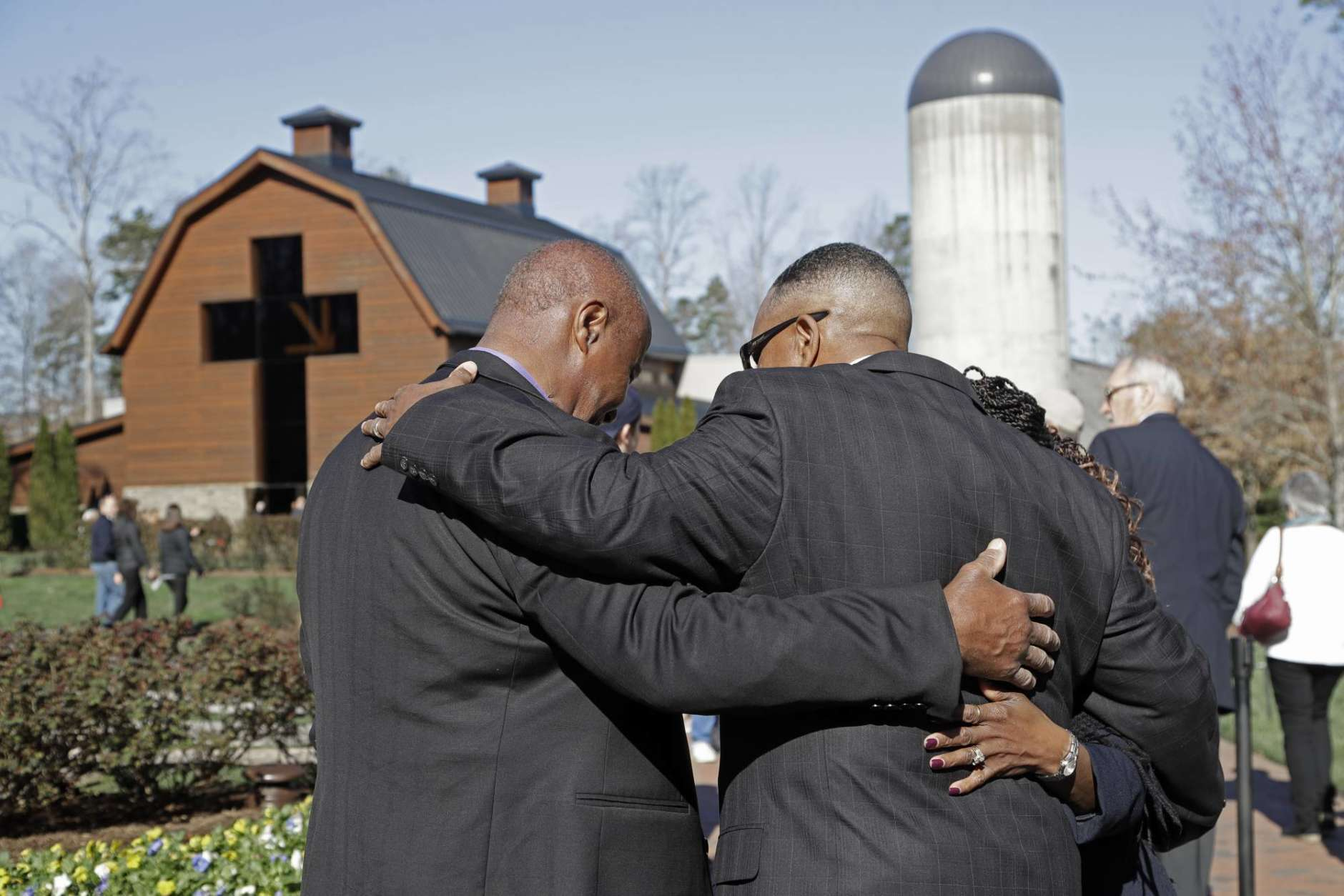 A group of people pray after paying their respects to Rev. Billy Graham during a public viewing at the Billy Graham Library in Charlotte, N.C., Tuesday, Feb. 27, 2018. (AP Photo/Chuck Burton)
