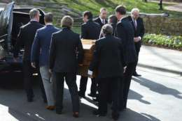 Pall bearers carry the casket carrying the body of Billy Graham to the Billy Graham Library in Charlotte, N.C., Saturday, Feb. 24, 2018. Graham's body was brought to his hometown of Charlotte on Saturday, Feb. 24, as part of a procession expected to draw crowds of well-wishers. (Jeff Siner/The Charlotte Observer via AP)