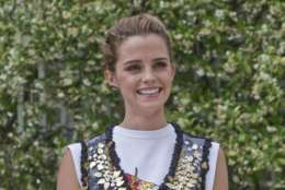 FILE - In this file photo dated Thursday, June 22, 2017, British actress Emma Watson poses during the fashion week in Paris, France. Stars including Emma Watson and Gemma Arterton are backing a British film industry plan to tackle bullying and sexual harassment. (AP Photo/Michel Euler, File)