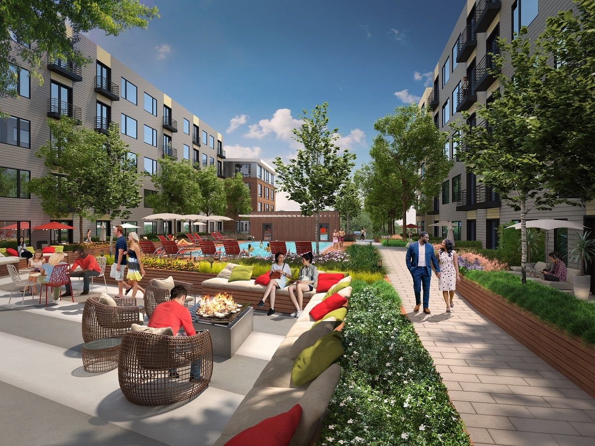 The apartment community's amenities include an open-air lounge with shuffleboard and billiard tables. (Courtesy VY/Reston Heights)