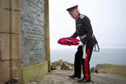 Lord Lieutenant of Argyll and Bute, Patrick Stewart, lays a wreath during a service at the American Moment at the Mull of Oa on Islay, Scotland, Friday May 4, 2018. Relatives of U.S. soldiers who died in two sea disasters off the coast of Scotland during World War I have traveled to the island of Islay for a service honoring those who were lost and the local people who rescued the survivors. The ceremony commemorates the sinking of two troop carriers, the SS Tuscania in February 1918 and the HMS Otranto eight months later, where some 700 U.S. servicemen and British crew members lost their lives. (Jane Barlow/PA via AP)