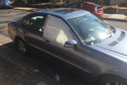 This car was one of 47 cars that were broken into in the Sheppard Park neighborhood in D.C. sometime on Wednesday night or early Thursday morning, D.C. police would not say whether the crimes were connected. (WTOP/Mike Murillo)