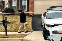 Homicide detectives investigate the death of a mother and her grown son in Loudoun County Thursday morning. (WTOP/Neal Augenstein)