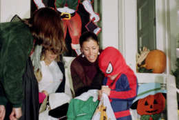 Marilyn Quayle, wife of Vice President Dan Quayle, hands out treats to children at the Vice Presidential residence in Washington  Saturday, Oct. 31, 1992. Quayle welcomed trick or treaters to the home, while her husband spent the day campaigning. (AP Photo/Dennis Cook)