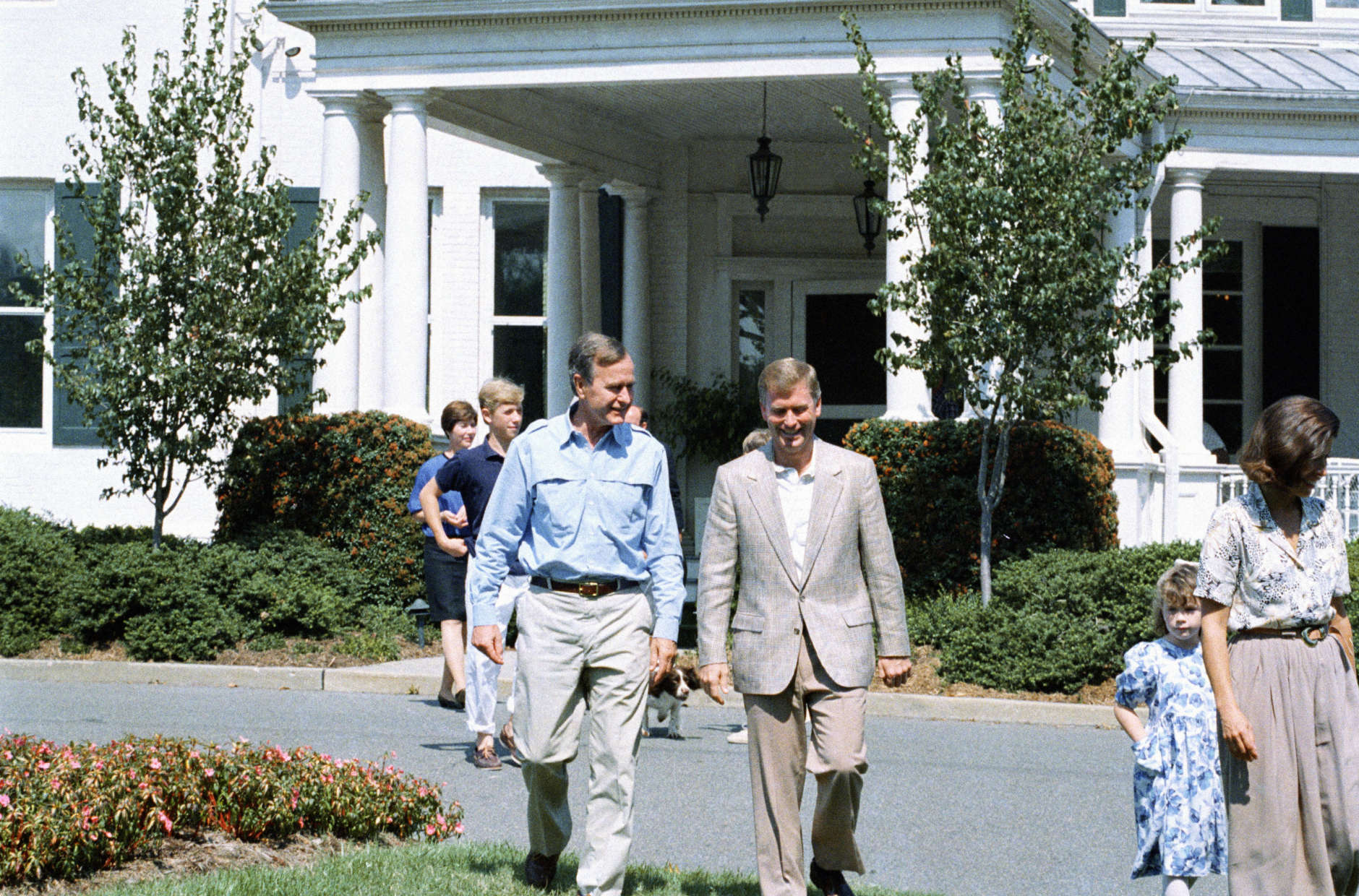 Vice President George Bush, left, walks with his running Sen. Dan Quayle of Indiana, prior to a lunch Bush gave for Quayle and their families at the vice president's residence in Washington on Sept. 11, 1988. (AP Photo/Charles Tasnadi)
