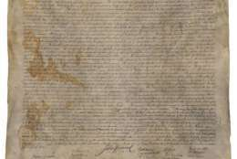 This April 5, 2017 image provided by Seth Kaller, Inc. shows a rare parchment copy of the Declaration of Independence, made in Washington in the 1820s for founding father James Madison. During the Civil War, the precious document was hidden behind wallpaper in a home in Virginia to keep Union soldiers from finding it. Later, it sat in a closet in Kentucky, in a broken frame, unappreciated and stored in a cardboard box. (Seth Kaller INC. via AP)