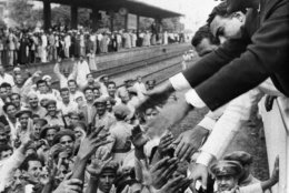 Egypt's President Gamal Abdel Nasser stretches his arms to greet fellow Egyptians during a stop at one of the stations en route from Alexandria to Cairo, July 28, 1956. Earlier Nasser shouted an angry reply to British and French protests against his nationalization of the all-important Suez Canal. he was welcomed by cheering crowds which greeted him on his return to the capital, where he announced the taking-over of the canal the night of July 27.  (AP Photo)