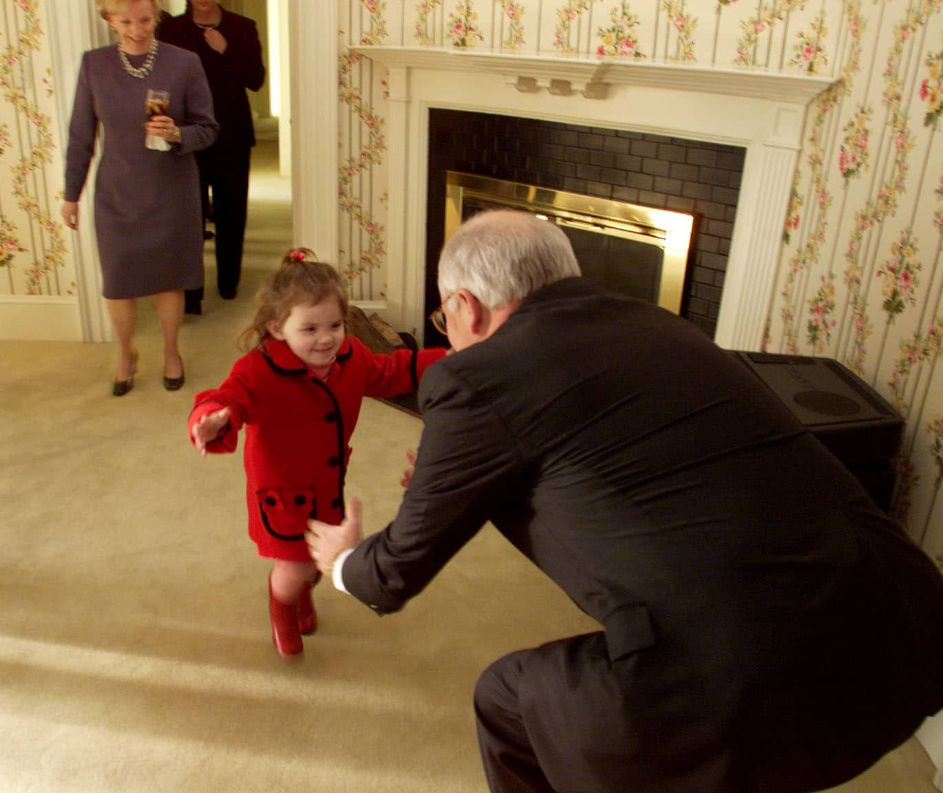 WASHINGTON, DC - JANUARY 01: Vice President Dick Cheney photographed from 1975 to 2006 in Washington, DC. Pictured: Vice President Dick Cheney reaches out to granddaughter Elizabeth at the VP residence as Lynne Cheney watches on January 21, 2001.  (Photo by David Hume Kennerly/Contour by Getty Images)