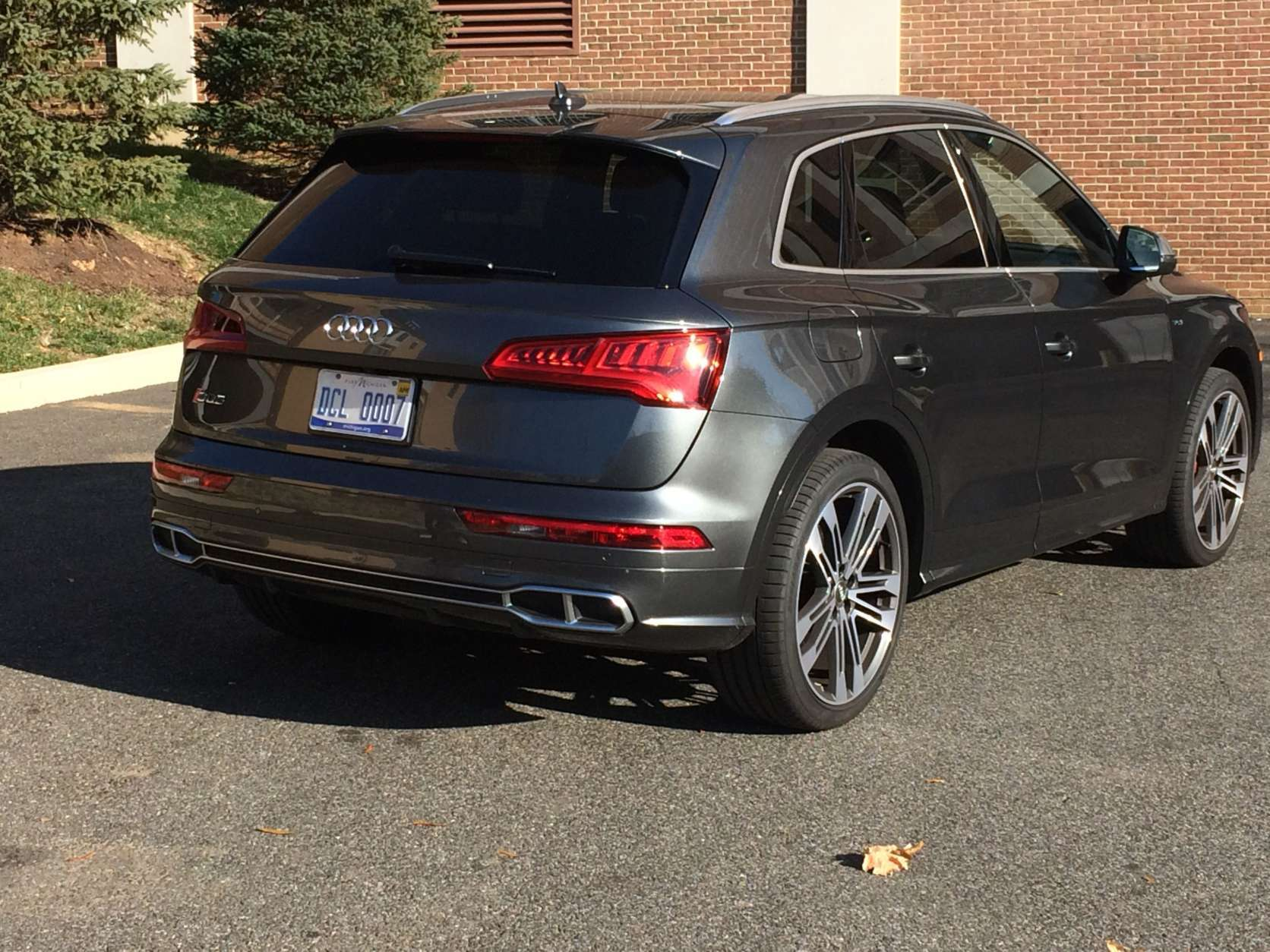 """A lower body treatment makes the SQ5 look hunkered down and closer to the road than the regular Q5, giving it a sportier look. Out back, the quad exhaust tips announce """"this is a crossover with an attitude,"""" but that's about the only giveaway other than the SQ5 badge. (WTOP/Mike Parris)"""