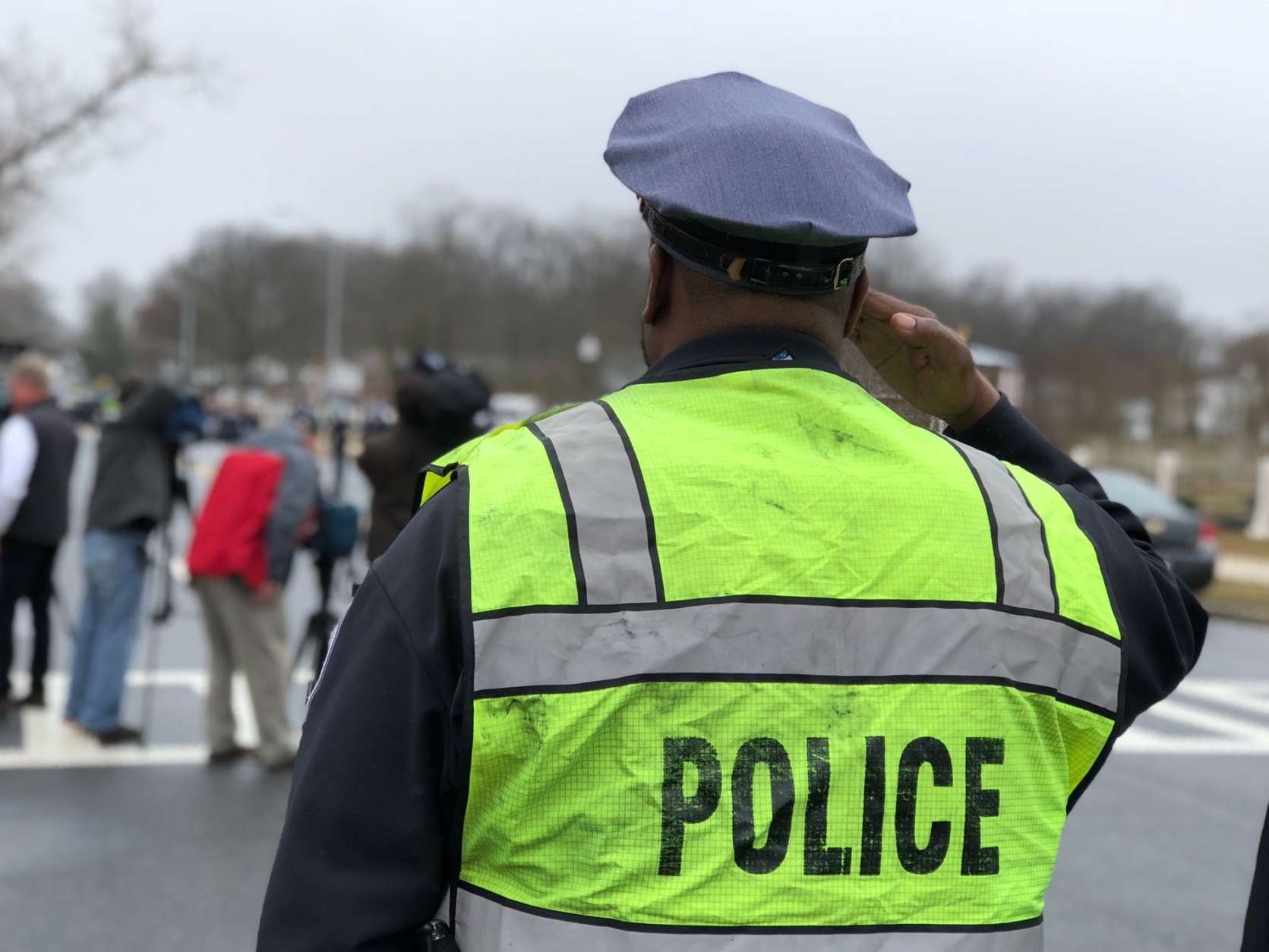 An officer salutes at the funeral of Cpl. Mujahid Ramzziddin on Friday. (WTOP/Kate Ryan)