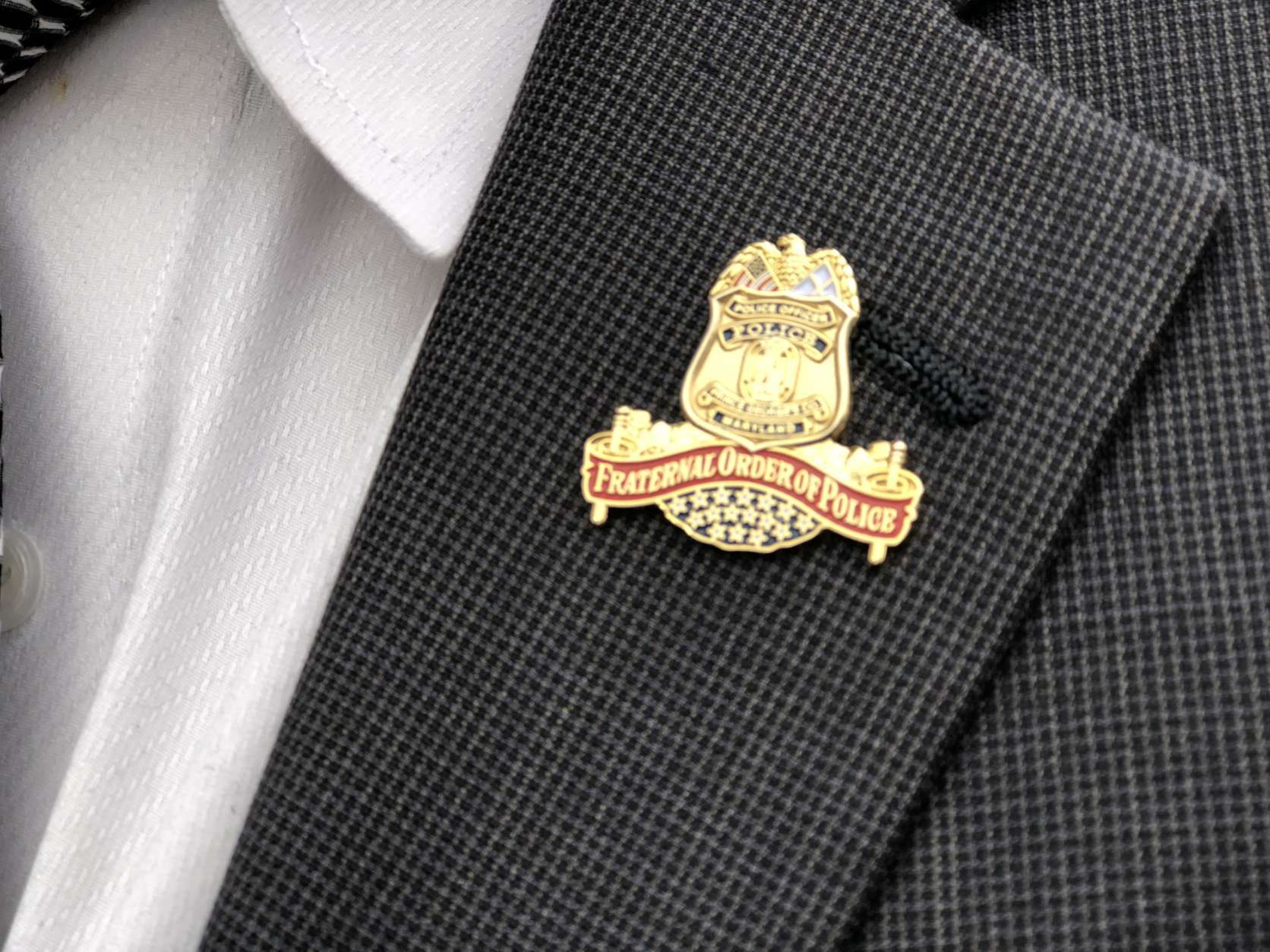 A Fraternal Order of Police pin worn at the funeral for Cpl. Mujahid Ramzziddin. (WTOP/Kate Ryan)