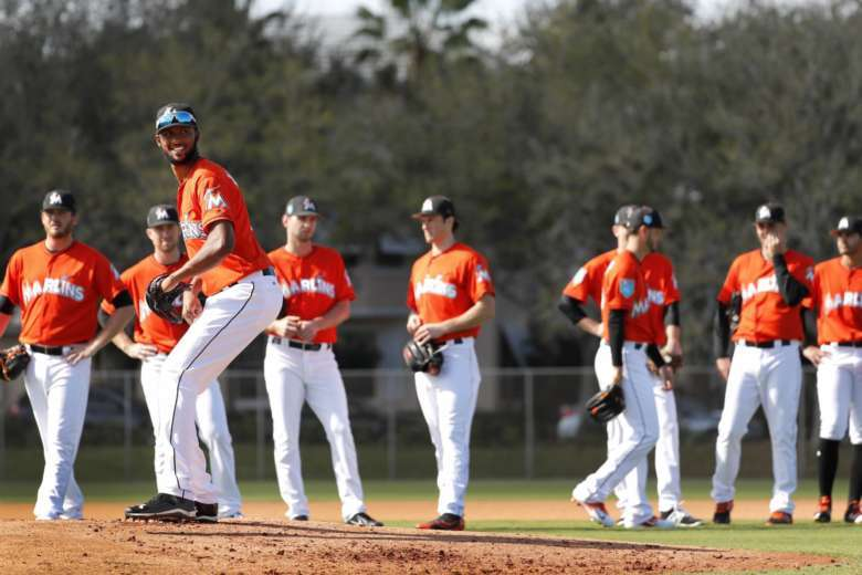 Derek jeters blueprint begins to take shape at marlins camp wtop miami marlins pitcher sandy alcantara stands on the mound as teammates wait their turn during a drill during spring training baseball practice sunday feb malvernweather Gallery