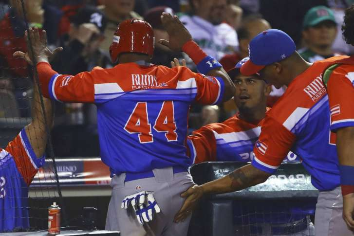 Anthony Garcia Left Of Puerto Rico S Criollos De Caguas Gets A Congratulatory Pat On His Backside As He Celebrates With Teammates After They Defeated