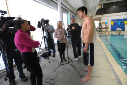 Olympic gold medalist Michael Phelps answers questions from reporters before training at the Meadowbrook Aquatic Center, Friday, Feb. 6, 2009, in Baltimore. The swimming superstar has been suspended for three months and had his training stipend revoked by USA Swimming. (AP Photo/Gail Burton)