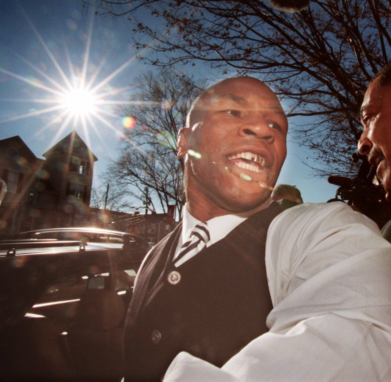 Former heavyweight champion Mike Tyson leaves court in Rockville, Md. Tuesday Dec. 1, 1998 after pleading no contest at his trial on two assault charges in connection with an August automobile accident. (AP Photo/Leslie E. Kossoff)