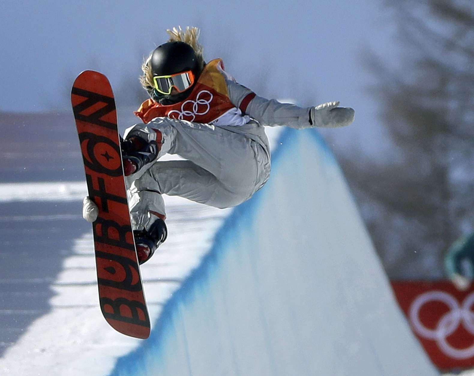 FILE- In this Feb. 13, 2018, file photo, Chloe Kim, of the United States, jumps during the women's halfpipe finals at Phoenix Snow Park at the 2018 Winter Olympics in Pyeongchang, South Korea. Before Kim won gold in the snowboarding halfpipe event, her infectious personality and heartwarming origin story had already won her sponsorships from Toyota, Samsung, Visa and others. (AP Photo/Gregory Bull, File)