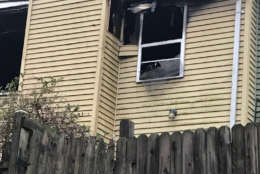 When firefighters arrived on the scene, the fire was visible from the rear of the house. They found the victim, 84-year-old Doris Miller, on the second floor with severe burns. She died from her wound shortly after arriving at the hospital. (WTOP/Kyle Cooper)
