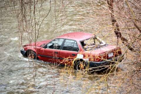 Man injured after car goes off road, into Rock Creek