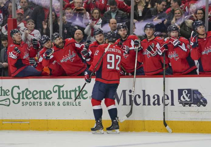 308a1bacf40 Senators Capitals Hockey 88676 Washington Capitals Evgeny Kuznetsov (92)  celebrates with teammates on the bench after scoring during the second  period ...