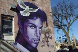 """In this Jan. 29, 2018 photo, a painting of the late Prince is shown on a Minneapolis building. Fans remember Prince for his electrifying halftime performance at the Super Bowl in 2007. The """"Purple Rain"""" singer died in 2016, so his followers can only imagine how he might have topped that at this year's game in his hometown of Minneapolis. But music producer Jimmy Jam says Prince is """"here in spirit,"""" with sights and sounds all over town in the leadup to the game. (AP Photo/Jeff Baenen)"""
