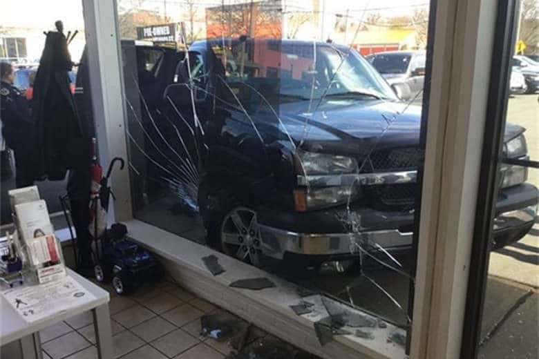 Driver Overdoses, Crashes Into Building With Passenger, Dog In Vehicle