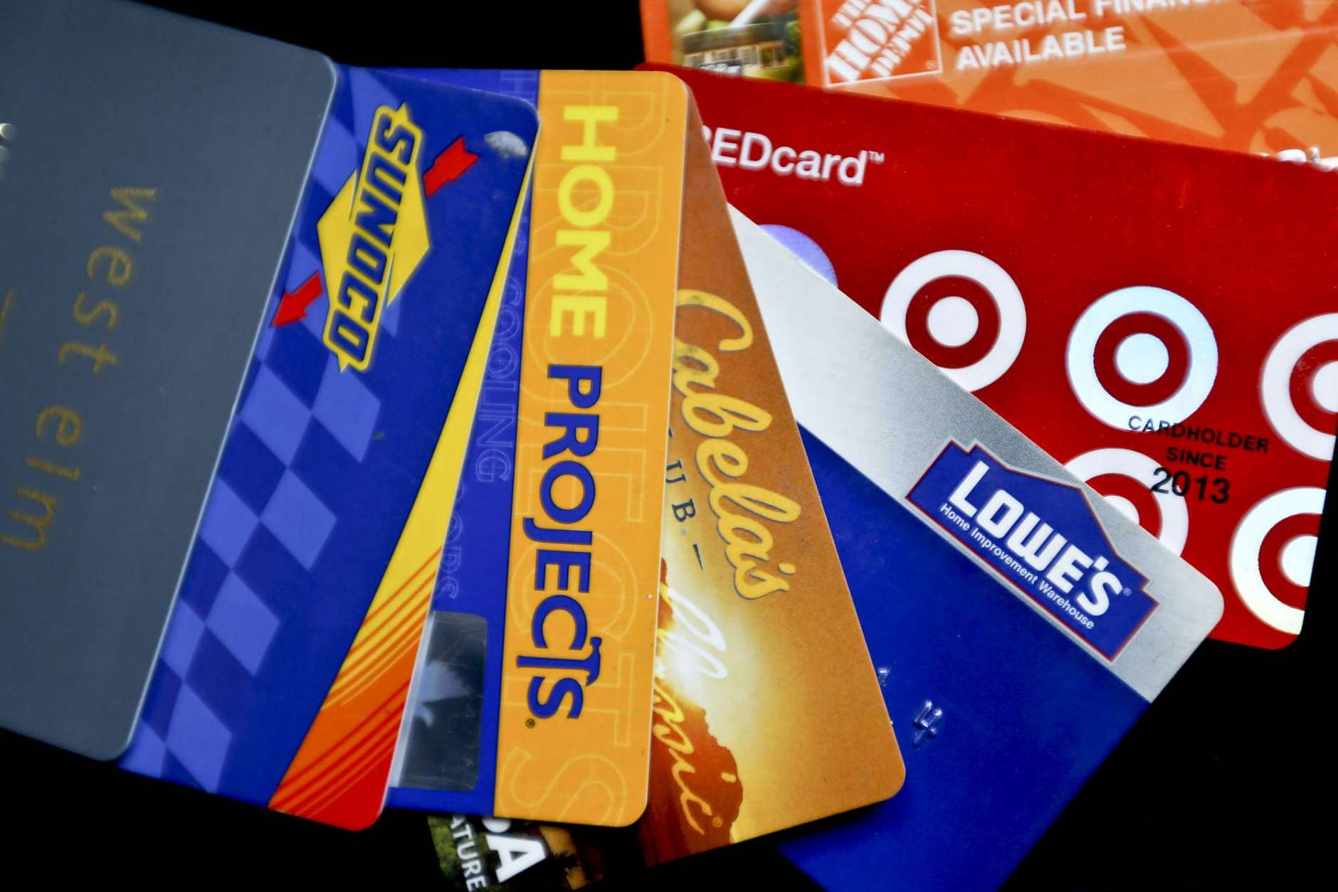 This Wednesday, Jan. 31, 2018, photo, shows an assortment of credit cards in Zelienople, Pa. The Federal Reserve issues new data Wednesday, Feb. 7, on how much credit Americans took on in December. (AP Photo/Keith Srakocic)