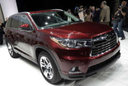 The 2014 Toyota Highlander is presented at the New York International Auto Show, in New York's Javits Center,  Wednesday, March 27, 2013. (AP Photo/Richard Drew)