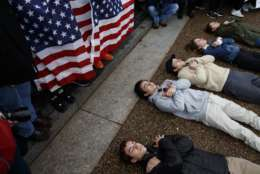 """Demonstrators participate in a """"lie-in"""" during a protest in favor of gun control reform in front of the White House, Monday, Feb. 19, 2018, in Washington. (AP Photo/Evan Vucci)"""