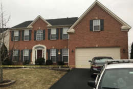 Photo shows a home on Tomey Court where 2 people were killed.