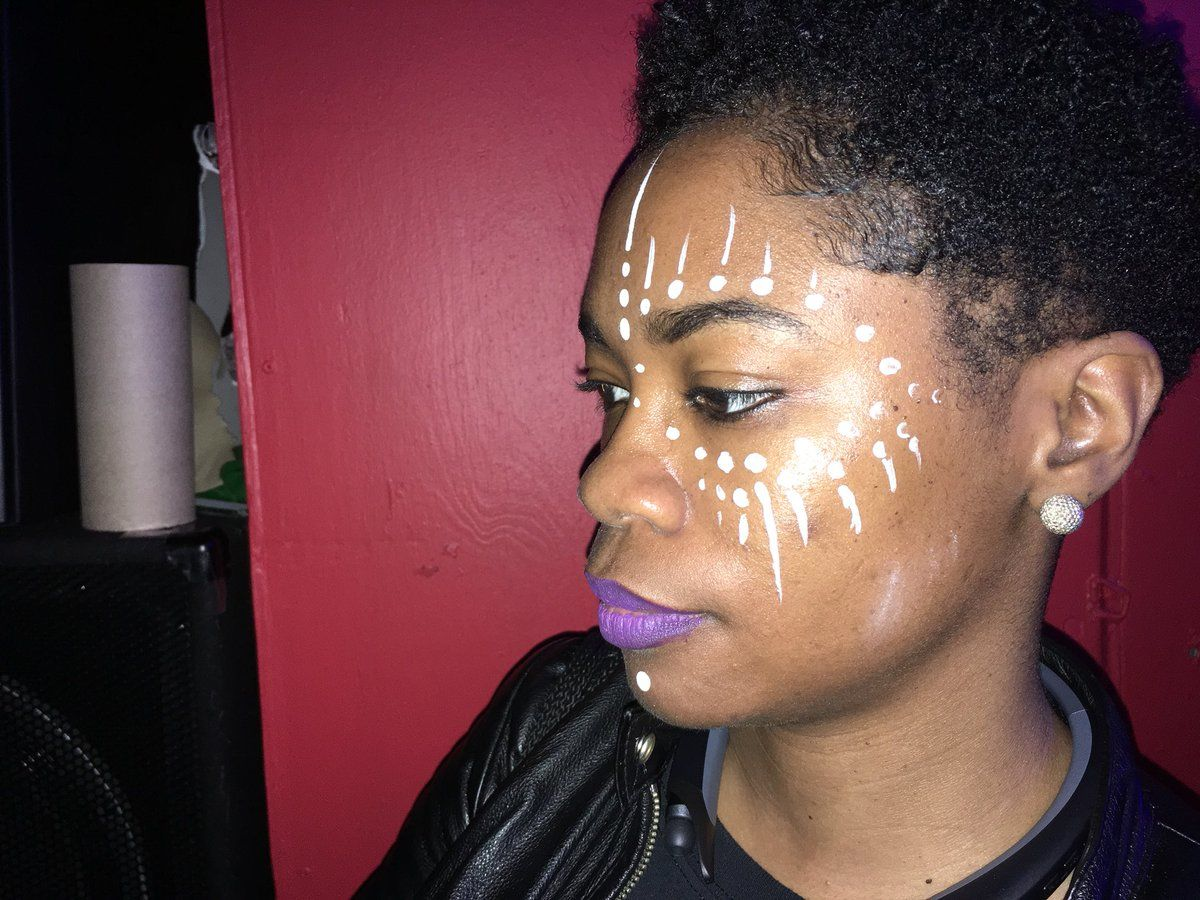 An artist was also available for facial paint designs inspired by warrior facial painting in the movie. (WTOP/Liz Anderson)