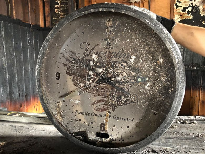 A clock from the bar was badly damaged by the intense blaze. (WTOP John Aaron)