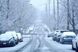 Snow falls in D.C., Feb. 17, 2018. (WTOP Dave Dildine)