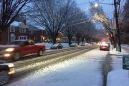 Roads became slushy in Silver Spring during Saturday's snowfall. (WTOP/Patrick Roth)